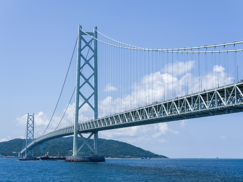 The suspension bridge connects the city of Kobe to Iwaya. Credit: Shutterstock.