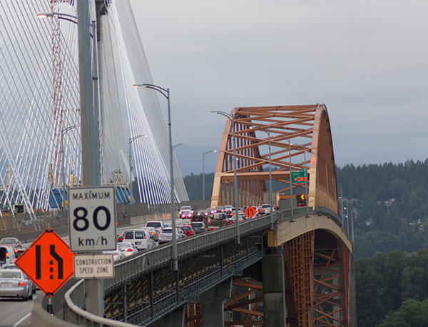 The new Port Mann Bridge is constructed beside the old bridge. Image courtesy of TimBray.