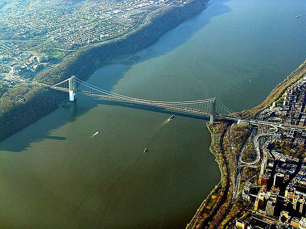 The George Washington Bridge is a double-deck suspension bridge over the Hudson River, connecting New York and New Jersey. Image courtesy of Bob Jagendorf.