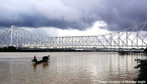 The Howrah Bridge spans over the Hooghly River