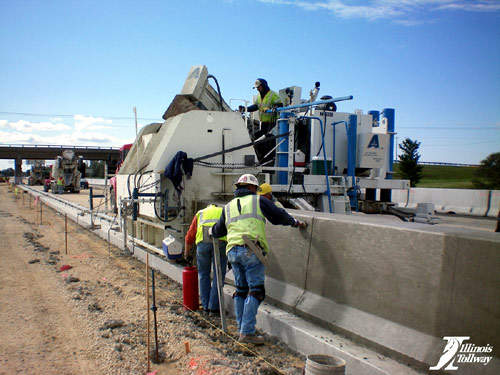 A concrete barrier wall is constructed on the Jane Addams Memorial Tollway, as part of the I-90 widening project.