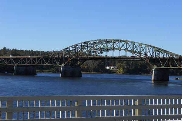 The existing Whittier bridge is a 1,346ft long double-barreled, three-span continuous riveted steel through truss bridge. Image courtesy of Botteville.
