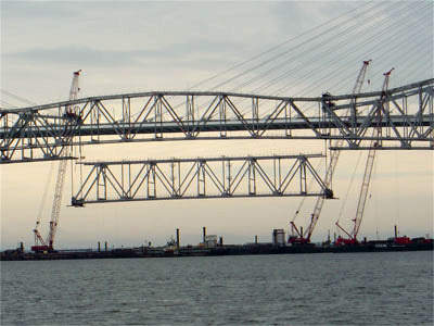 Section of the bridge being lifted into position.