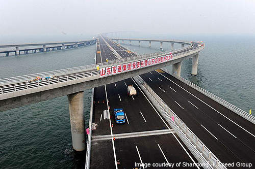 It was built to provide better links between the two fast growing  industrial areas either side of the bay. Qingdao Bay Bridge ...