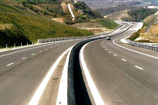The highway is a 24.5m-wide dual carriageway with two traffic lanes and an emergency lane in each direction.