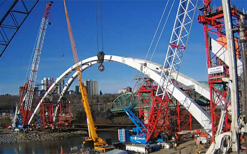 Two major arch lifts on the river were completed by April 2016. Image courtesy of  DIALOG.
