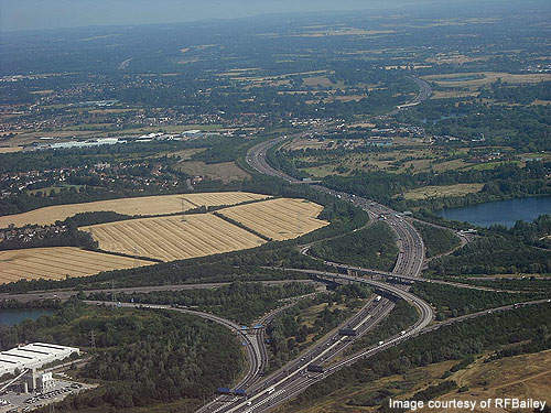 The M4/M25 motorway junction, near Heathrow Airport. The road was built as a three-lane motorway and later widened to four, five and six lanes.