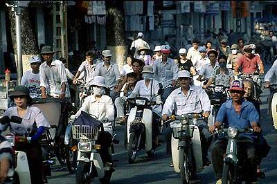 Lack of road development in Ho Chi Minh City has resulted in heavy traffic.