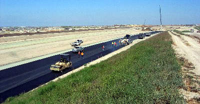 Paving underway on one of the road sections. Paving began in summer 2006.