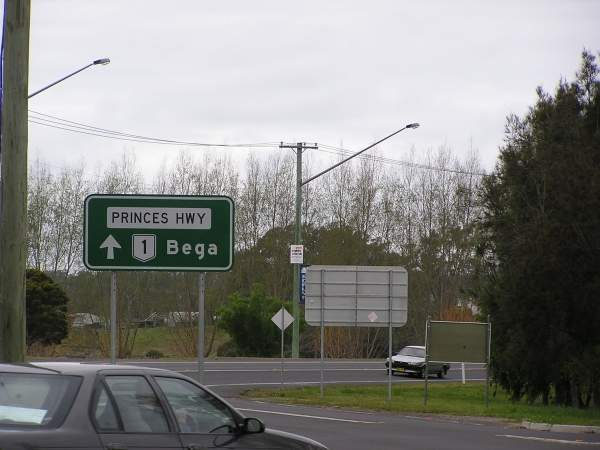 A display sign on the Princes Highway shows the direction to Bega.