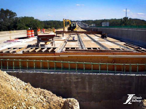 Crews work on the Burr Oak Bridge deck on the I-90.