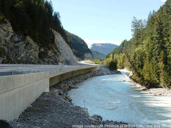 Some of the new road is cantilevered as there was no material to base it on, with the Kicking Horse River running alongside it.