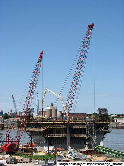 The project involved construction of a new bridge across the Mississippi river, construction of the Mississippi North I-70 interchange and Illinois I-70 connection, and the improvement of I-55/64/70 tri level interchange.
