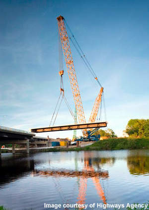 Bridge section being lifted into place.