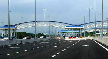 Road showing tunnel toll booths.