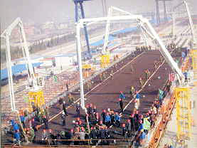 Construction work on the Hangzhou Bay Bridge began in June 2003 and completion is scheduled for 2008.