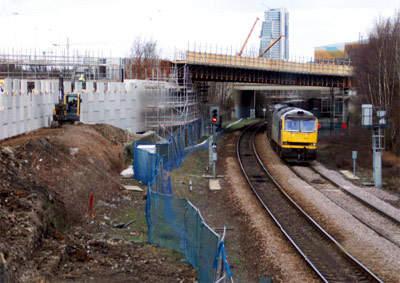 One of the three rail bridges with the concrete embankment.