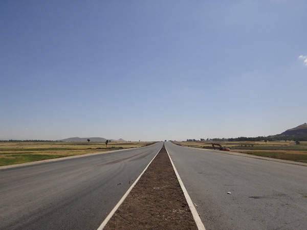 The new six-lane expressway speeds up the development of the country and offers job opportunities. Image courtesy of Ethiopian Roads Authority.