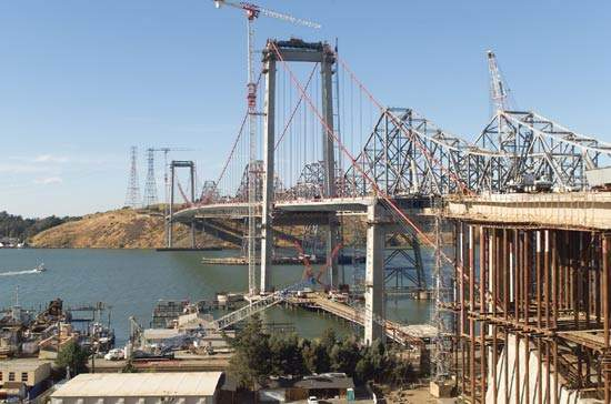 The 1927 westbound Carquinez Bridge across the Carquinez Straits, San Francisco Bay area, has been replaced with a new twin-tower suspension bridge.