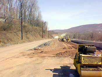 Excavating and hammering rock at the Mt. Pleasant Road intersection with old Route 22/322 to begin c
